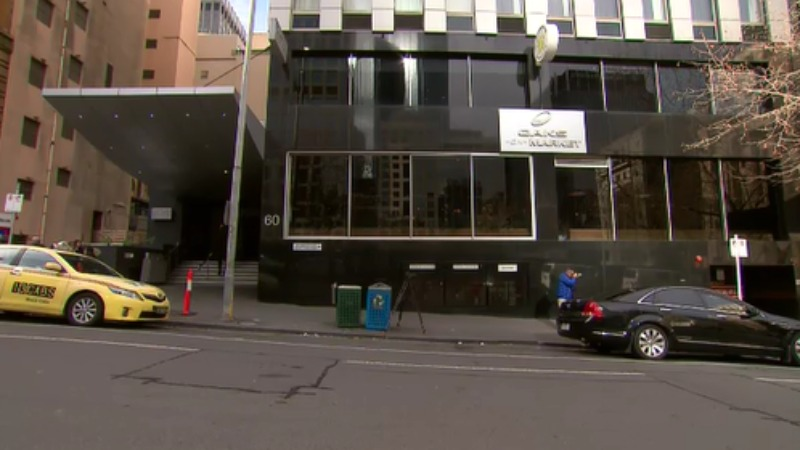 Woman dead in Melbourne hotel, men quizzed