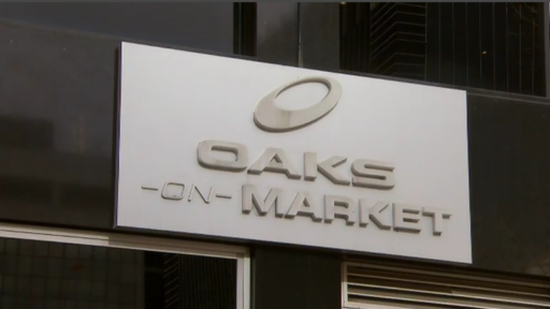 The woman's body was found at Oaks serviced apartments on Market Street. (9NEWS)