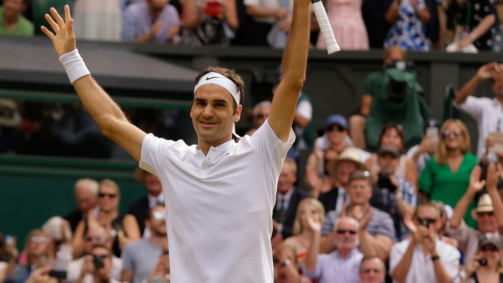 Roger Federer makes Wimbledon history by winning eighth title. (AAP)