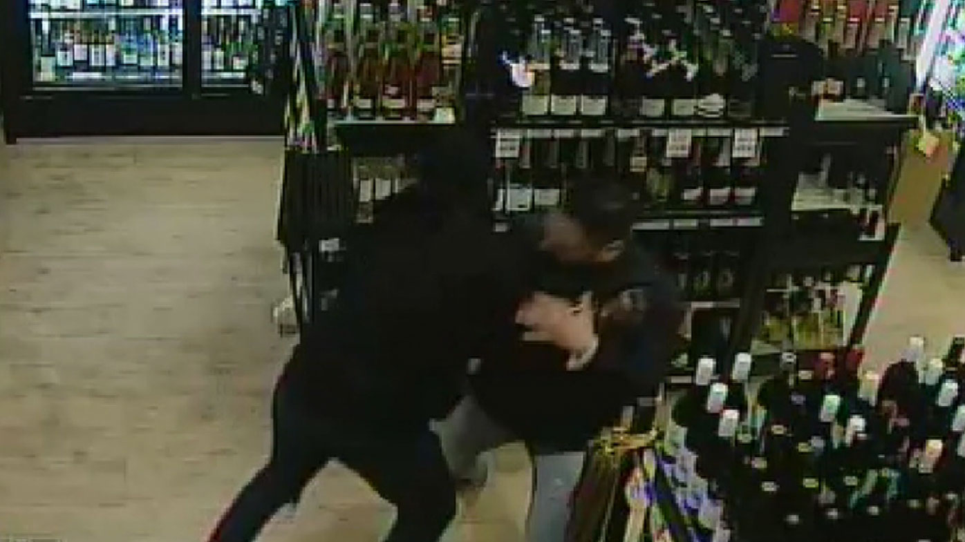 Mr Singh grapples with a would-be robber.
