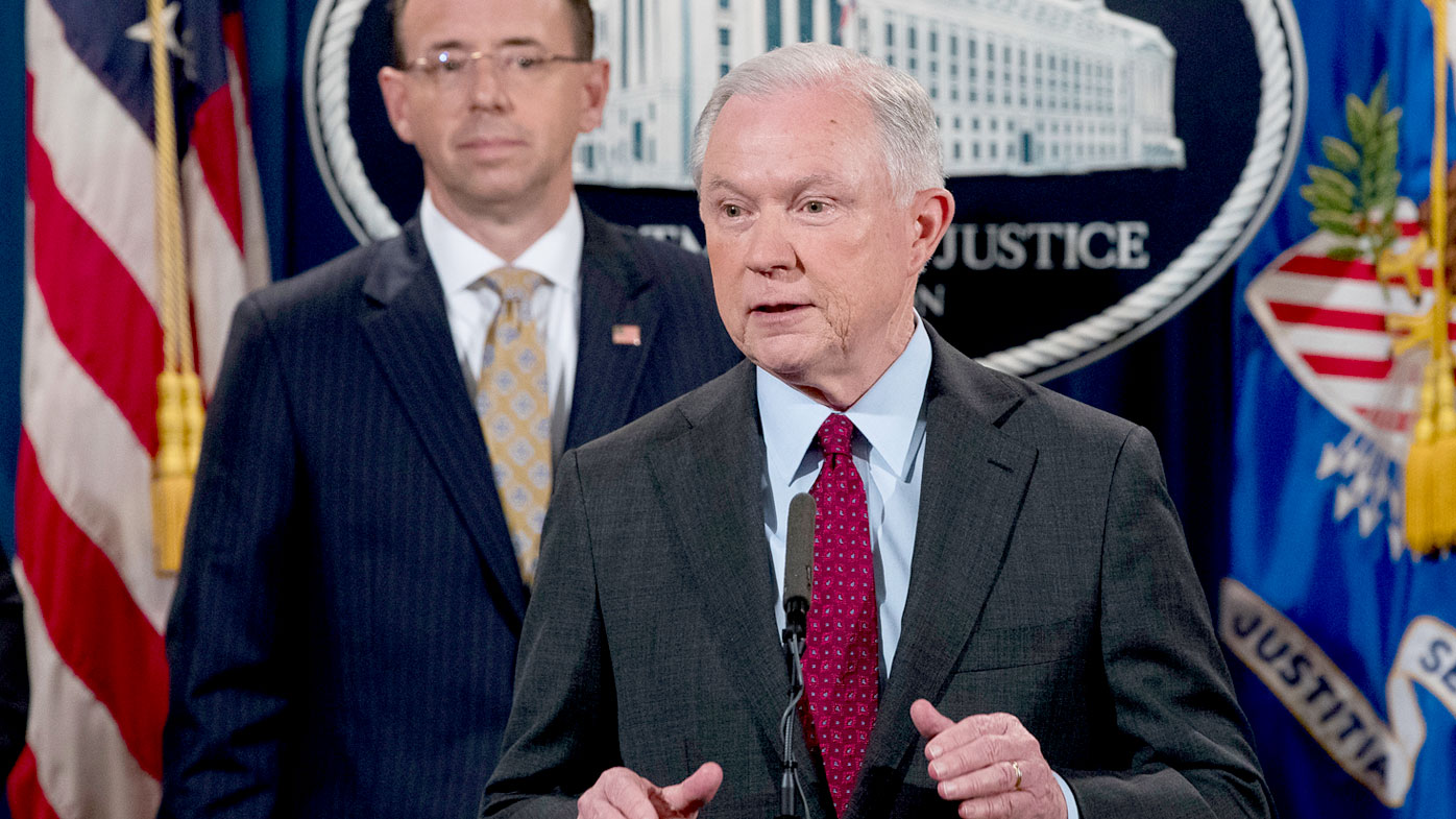 Attorney General Jeff Sessions accompanied by Deputy Attorney General Rod Rosenstein, left, speaks at a news conference to announce an international cybercrime enforcement action at the Department of Justice. (AAP)