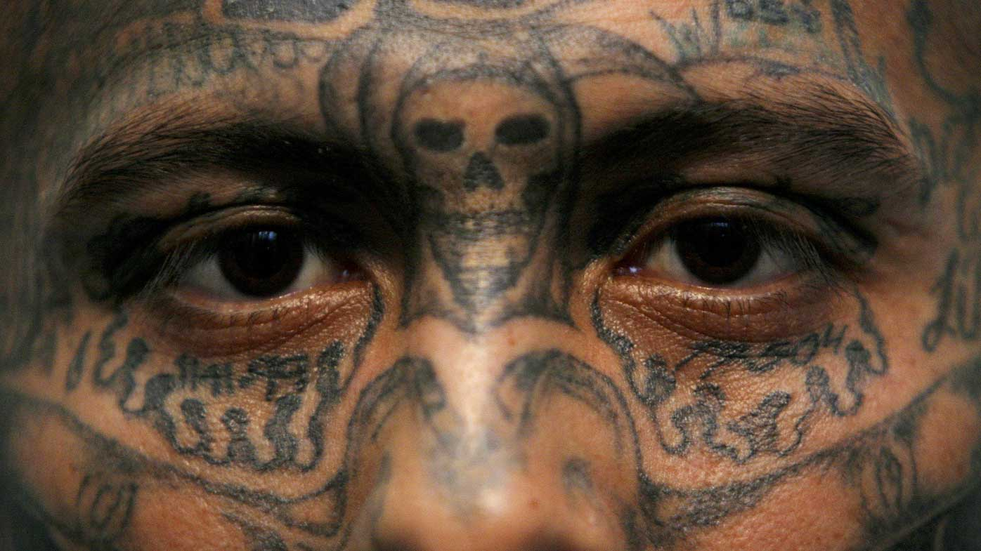 The facial tattoos of an MS-13 gang member in a Honduras prison. (AAP)