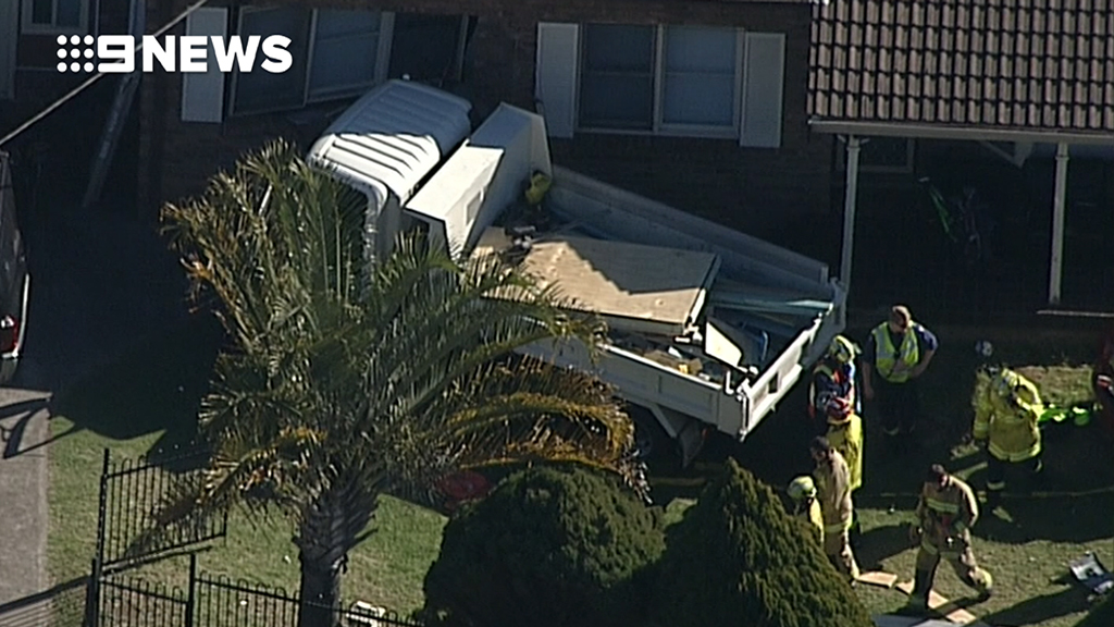 Elderly man dead after truck ploughs into Sydney house""