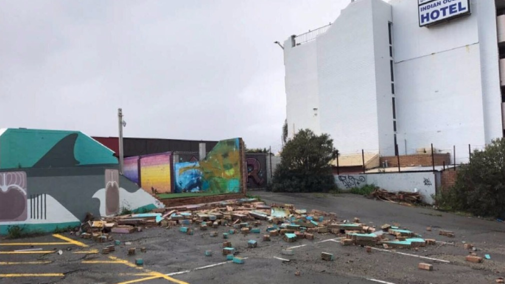 Damage caused by the waterspout was visible in a carpark. (9NEWS)
