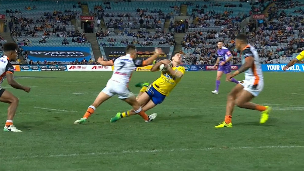 Luke Brooks trips Mitchell Moses.