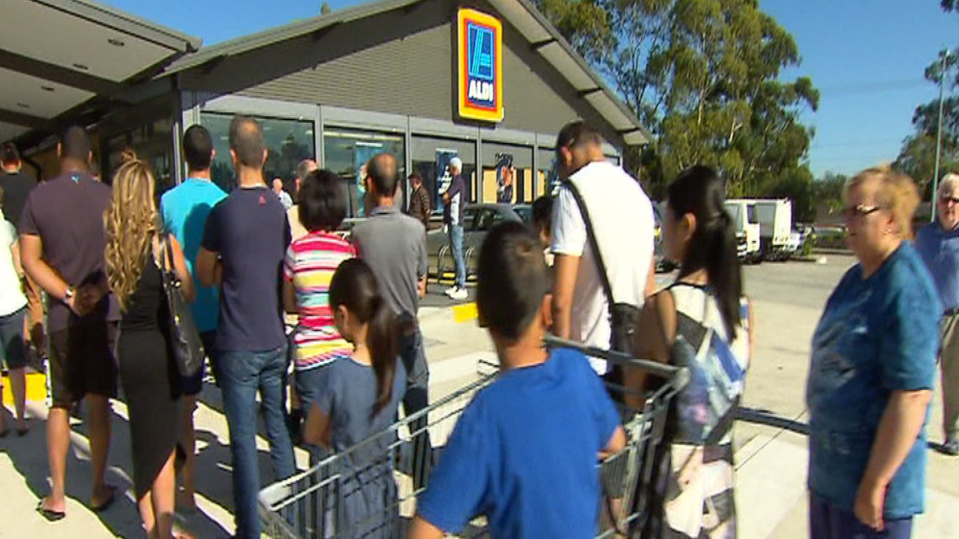 People line up at some stores for hours to take advantage of the low prices.