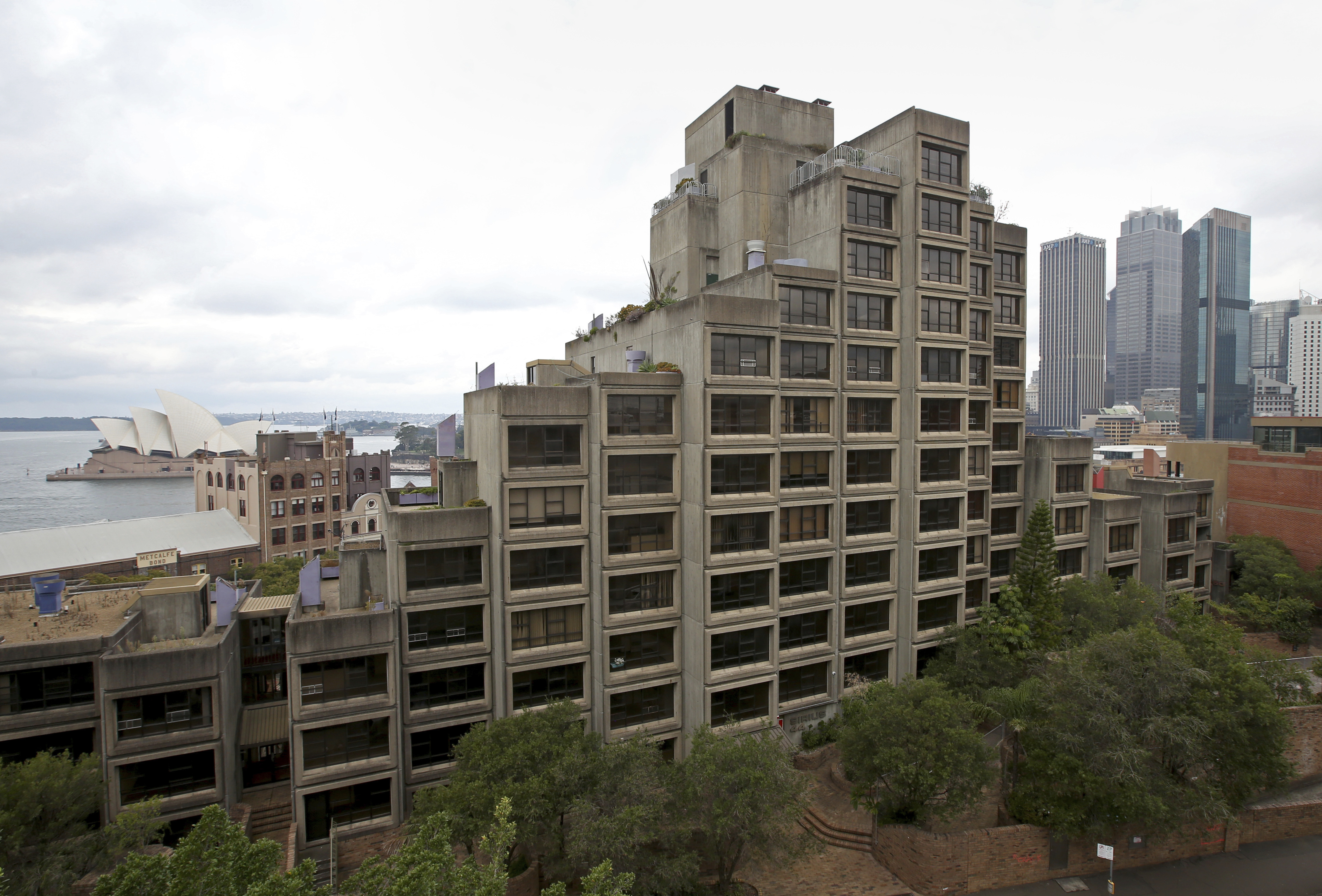 The Sirius building, constructed in the Brutalist style, overlooks the harbor and Opera House in Sydney. (AAP)