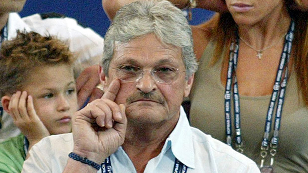 Nick Philippoussis watches son Mark Philippoussis play against Dominik Hrbaty of the Slovak Republic in a men's singles match in the Hopman Cup at the Burswood Dome in Perth on January 2005. (AFP)
