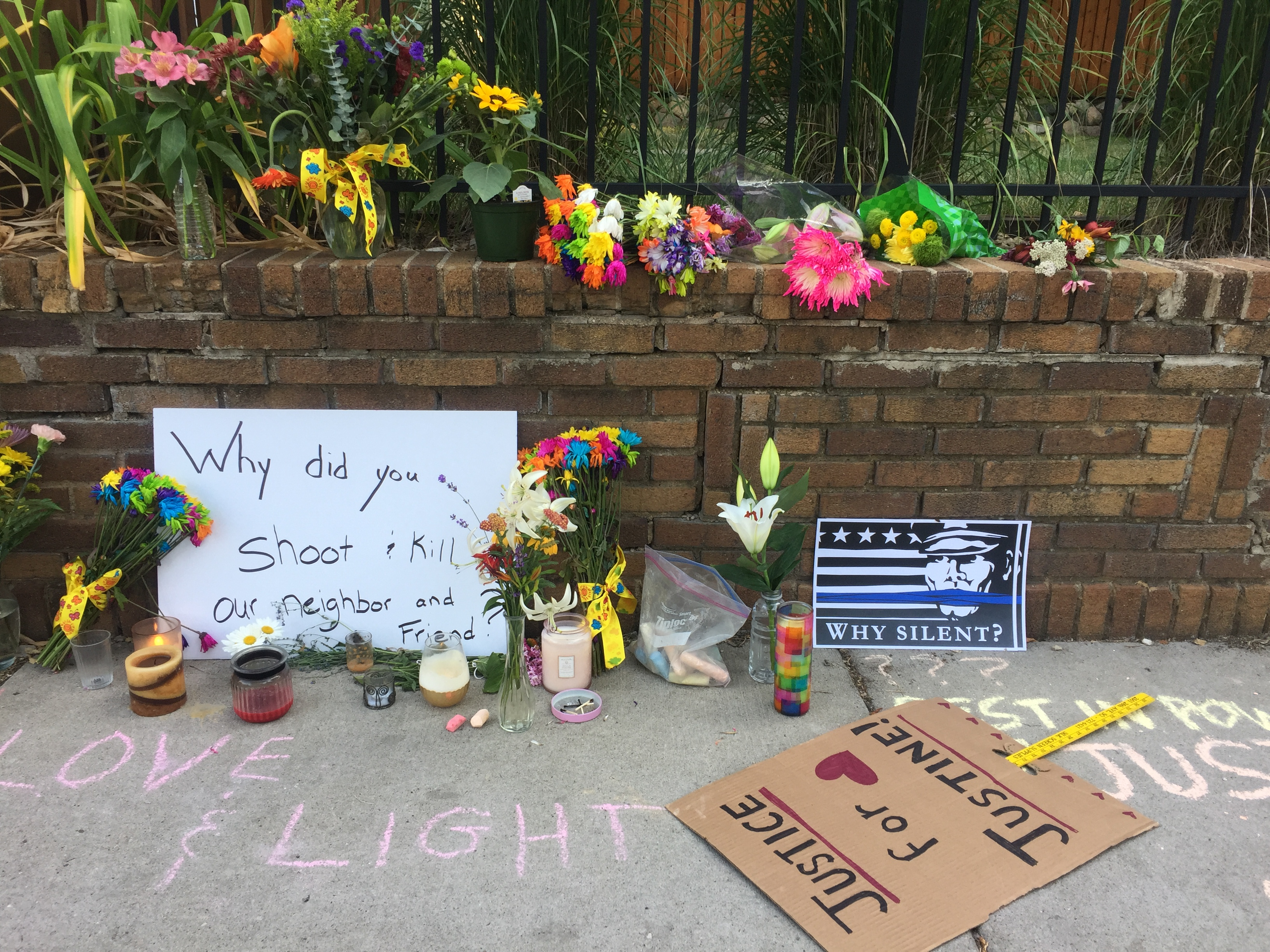 Signs and tributes on the street. (9NEWS)