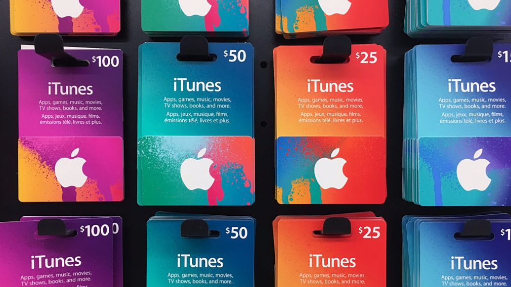 The scammers coerced the woman into buying more than 300 iTunes cards. (Getty Images)
