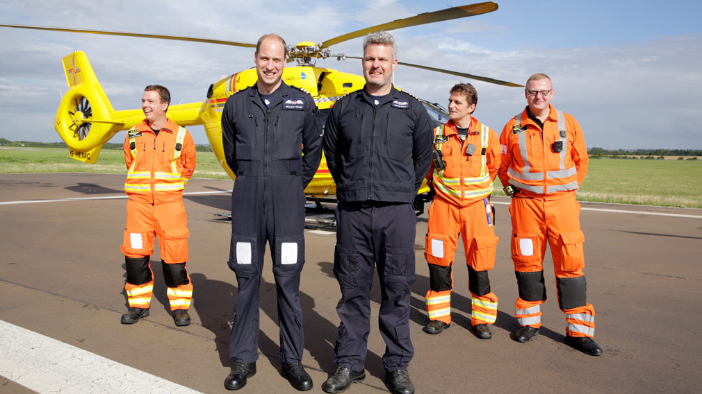Prince William stands with colleagues at the start of his final shift. (AAP)