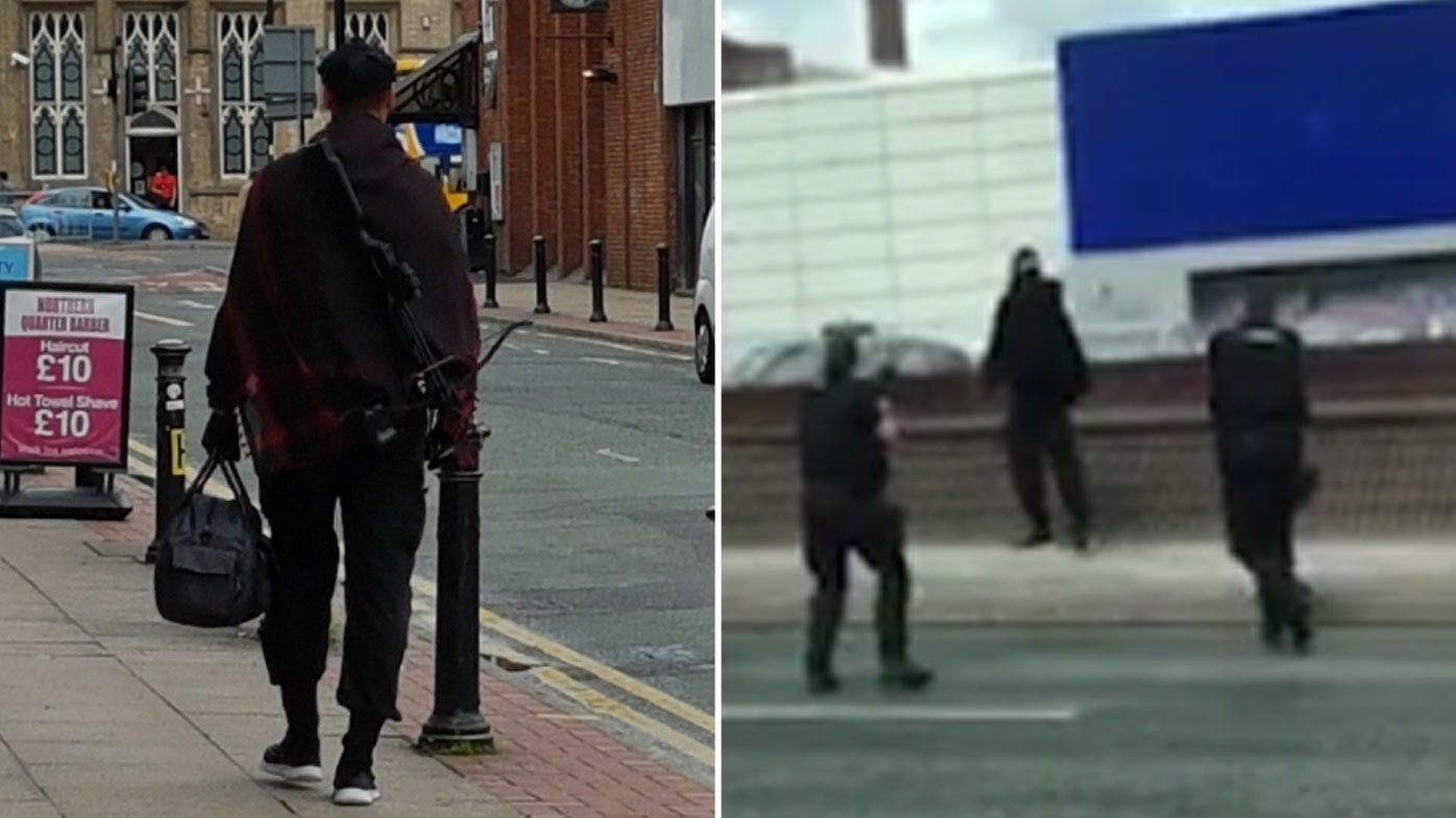 The man was pictured carrying the crossbow before he was surrounded by police. (Twitter)
