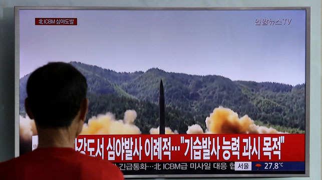 A South Korean watches file vision of a North Korean missile launch. (AAP)