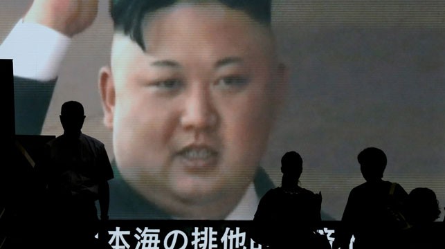 Japanese citizens take in the news of a North Korean missile test earlier this year. (AAP)