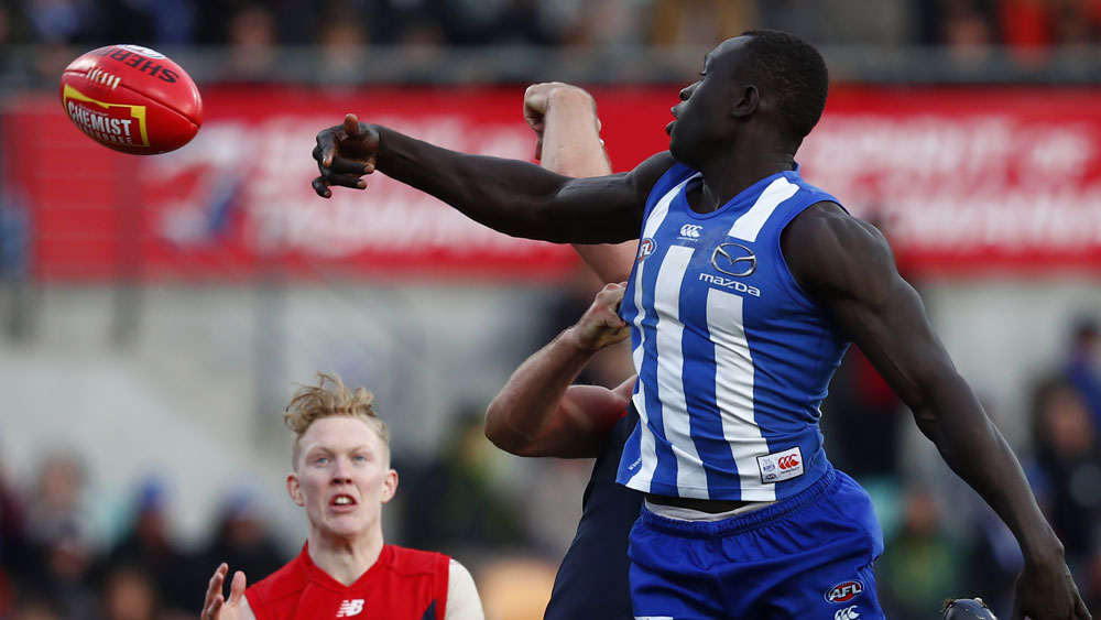 North Melbourne ruckman Majak Daw in action against Melbourne. (AAP)