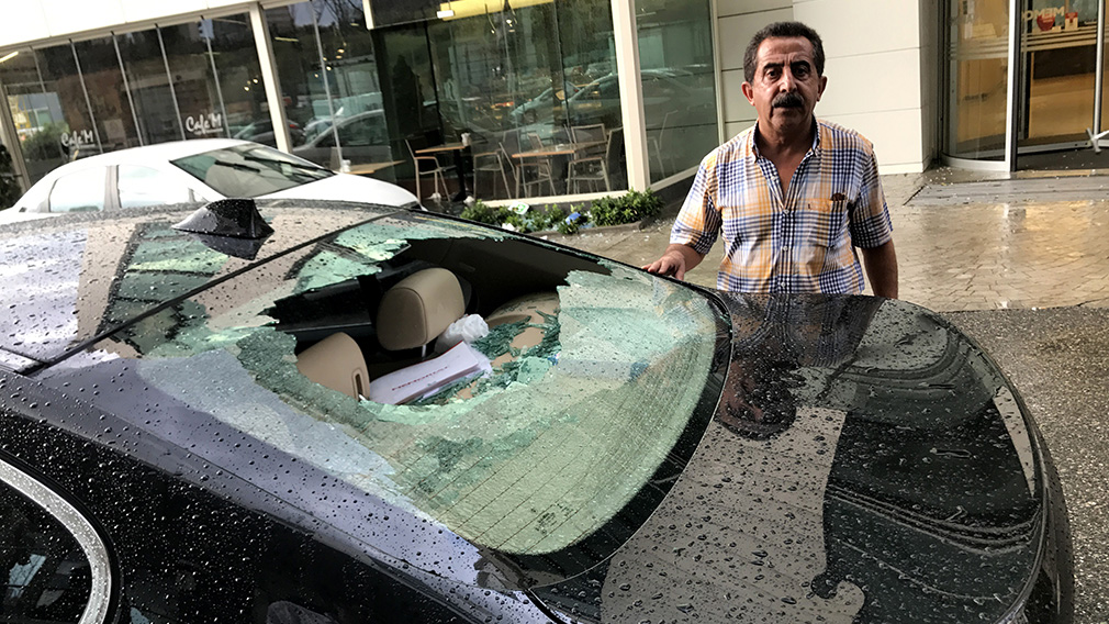 The large hail damaged property across the city. (AFP)