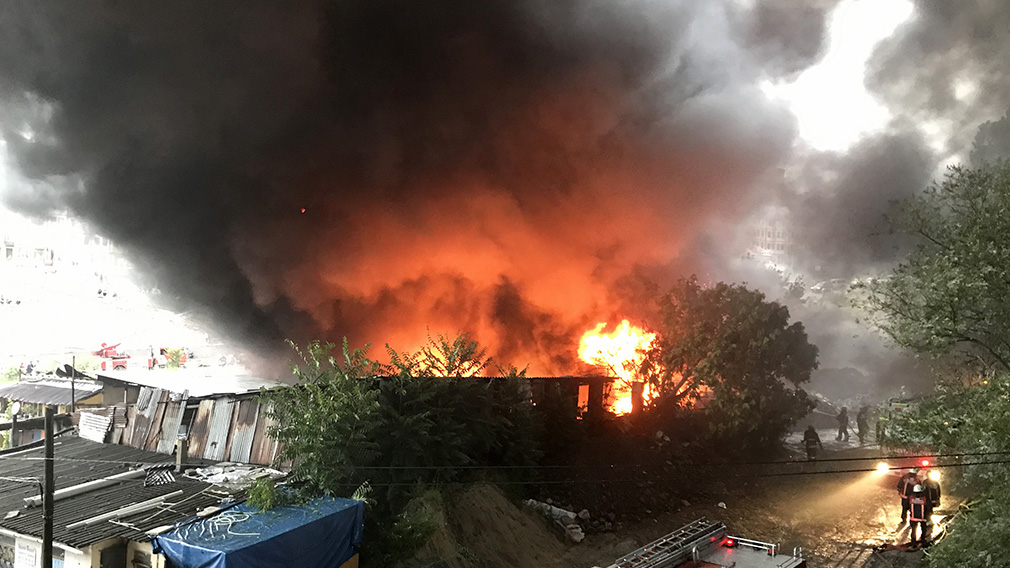 A plastics store went up in flames after it was struck by lightning. (AFP)