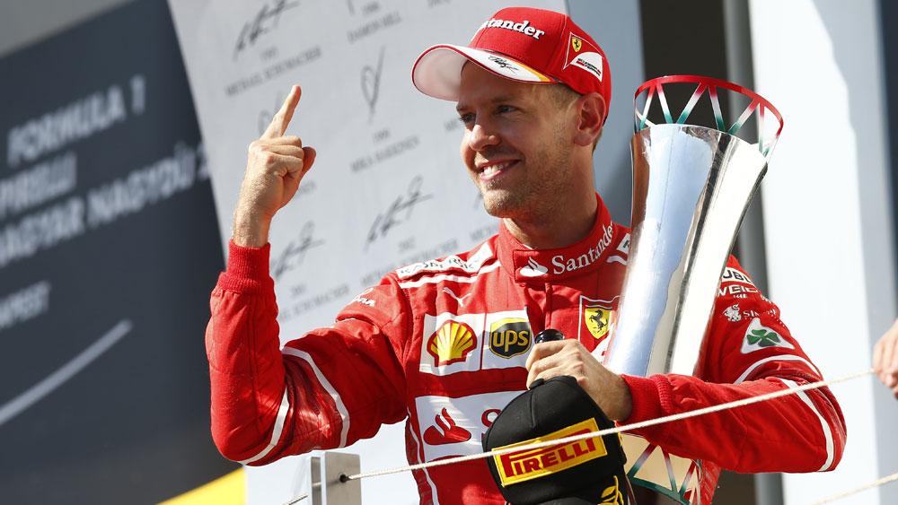 Sebastian Vettel overcomes steering difficulties to win tense Hungarian Grand Prix