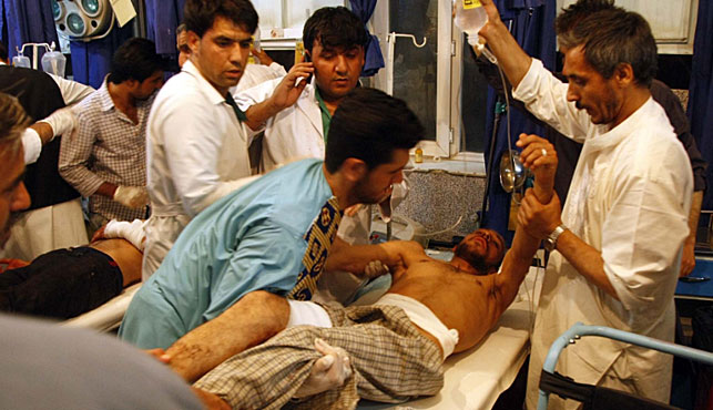 A victim is treated in hospital after the attack. (Photo:AFP).