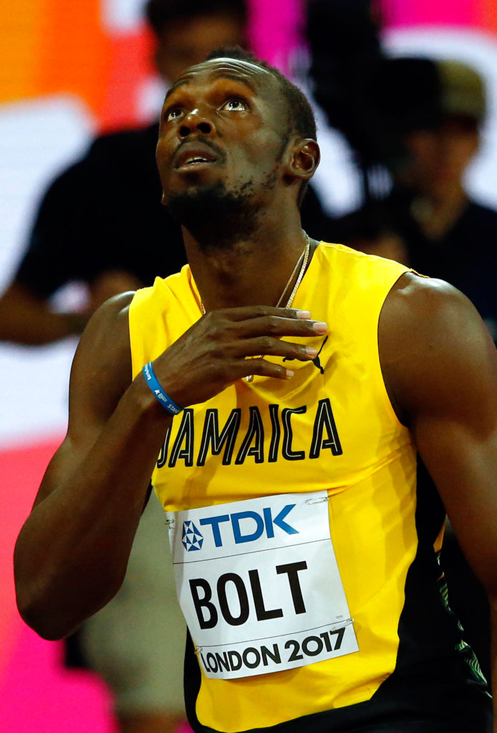Jamaica's Usain Bolt looks on before a men's 100m heat during the World Athletics Championships in London.  (Image: AP Photo/Matthias Schrader)