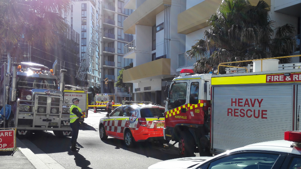 Three hurt after crane collapses onto Sydney apartment building