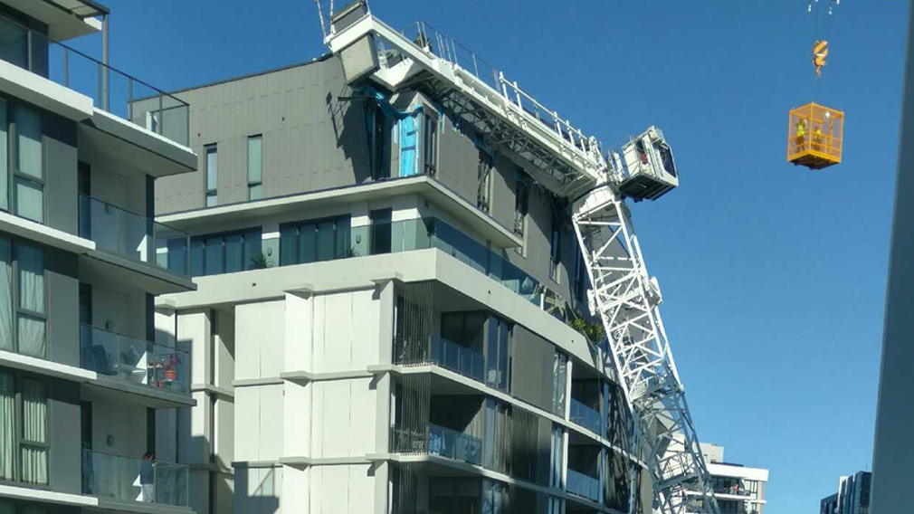 Crane collapses onto apartment block at Wolli Creek injuring three people