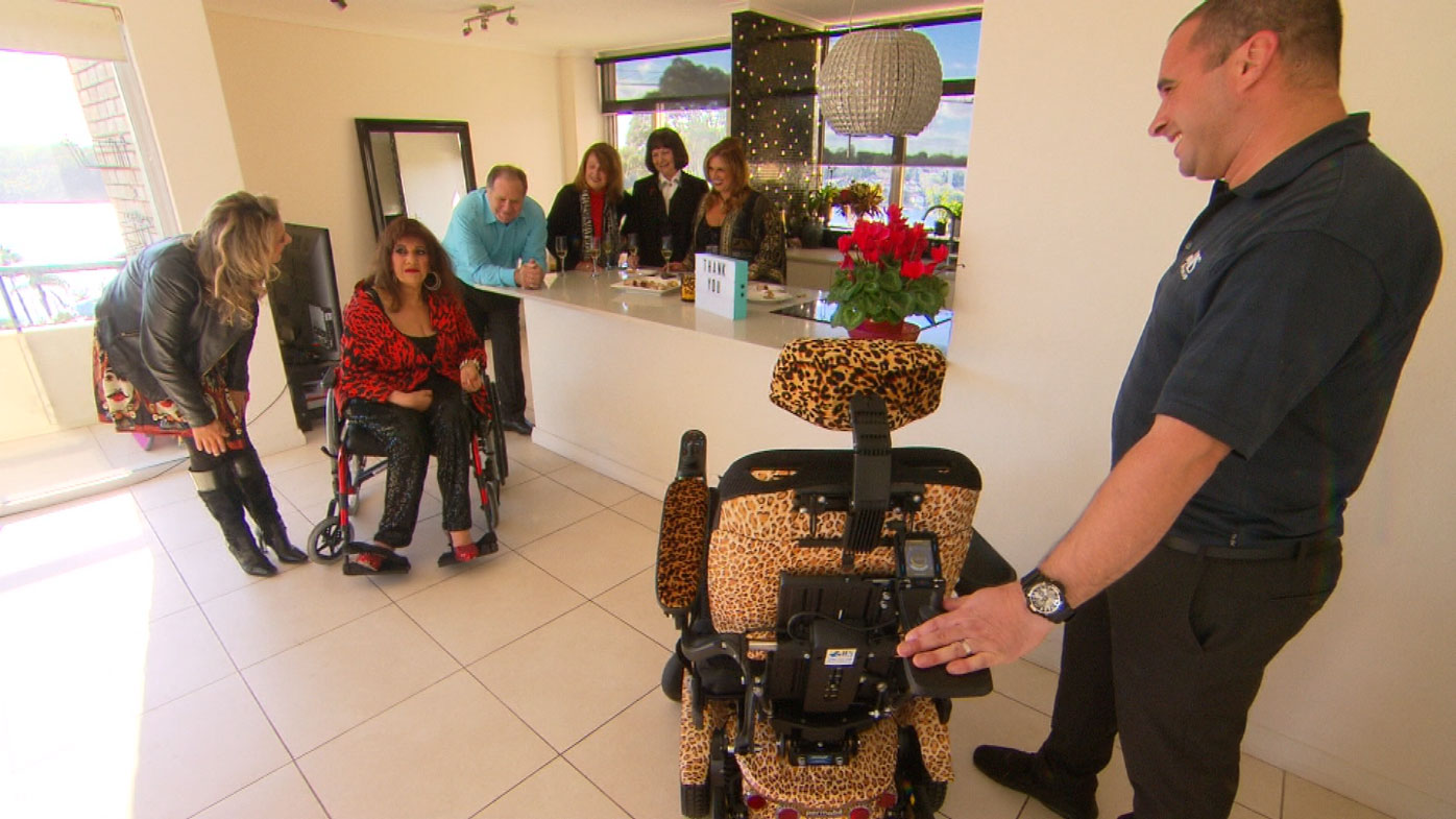 Maria is presented with a special leopard-print wheelchair.