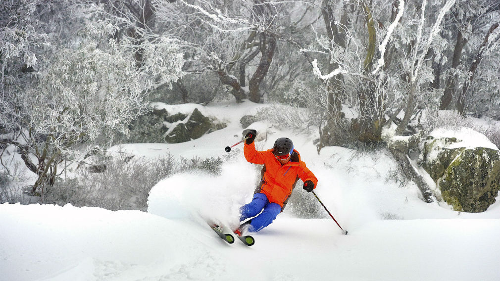 A skier enjoying snowfall at the Mount Buller Ski Resort in the Victorian Alps. (AAP stock)