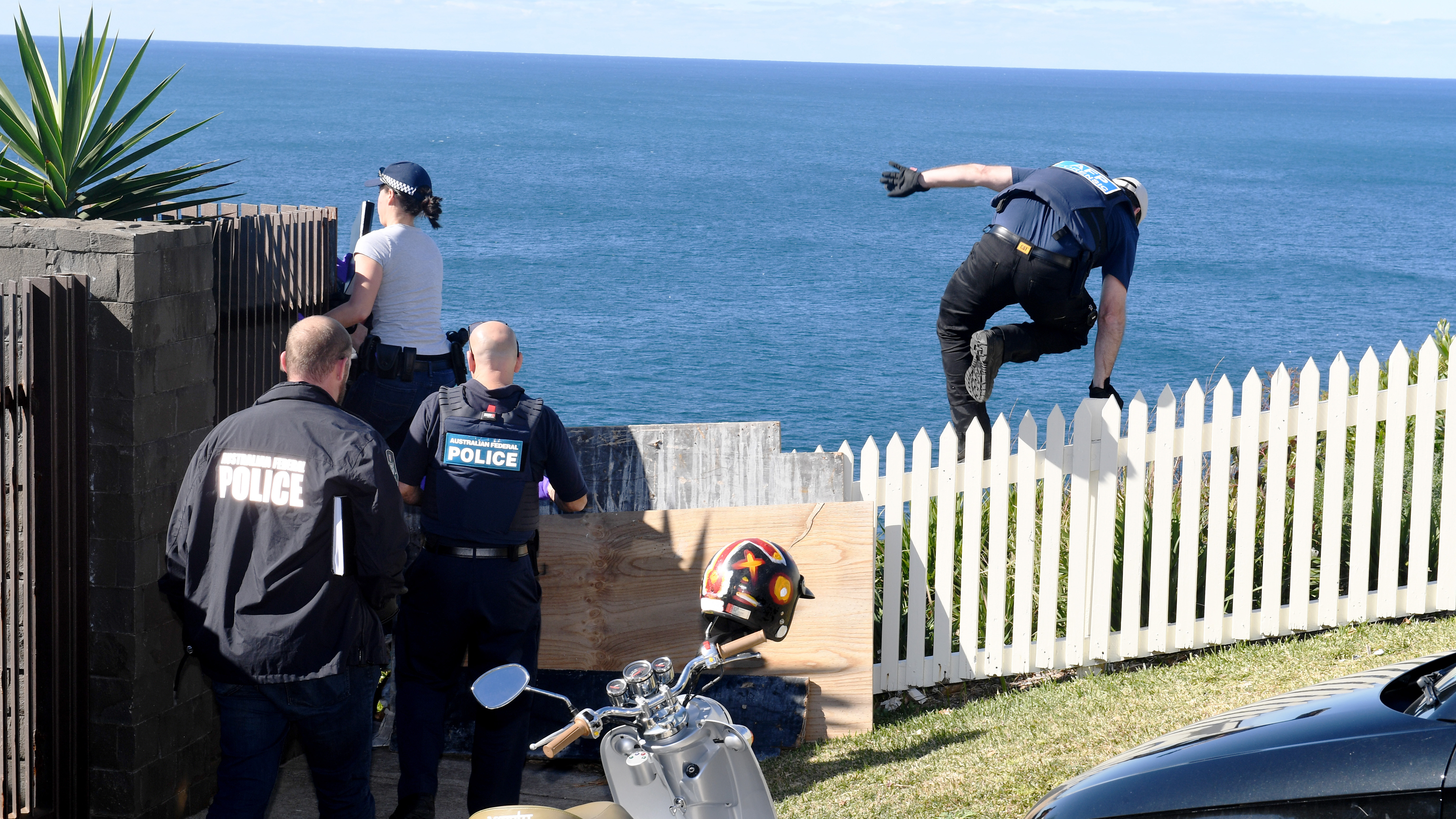 Police are seen at the home of Kings Cross club owner John Ibrahim during a police operation in Sydney. (AAP)