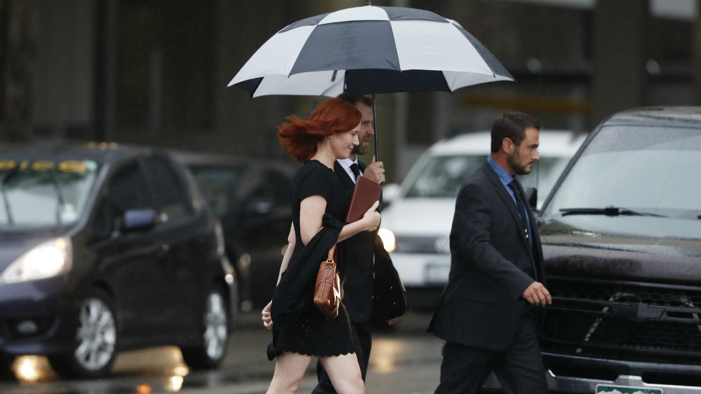 Tree Paine, publicist for pop singer Taylor Swift, walks back to a hotel after attending the jury selection phase in a civil trial in federal court on Monday. (AAP)