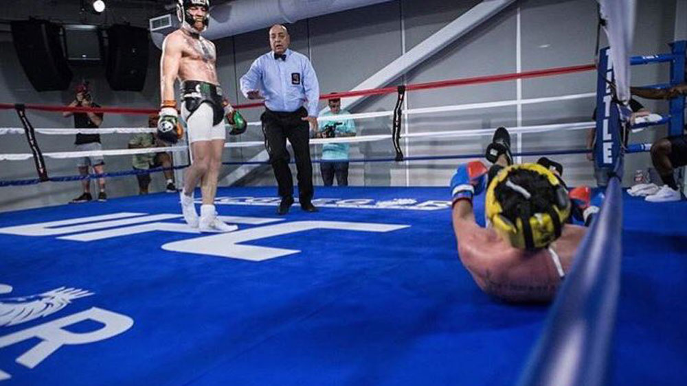 Conor McGregor and Paulie Malignaggi.