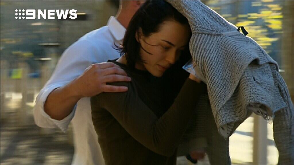 Sarah Budge leaves Sydney Police Centre after posting a $50,000 surety. (9NEWS)