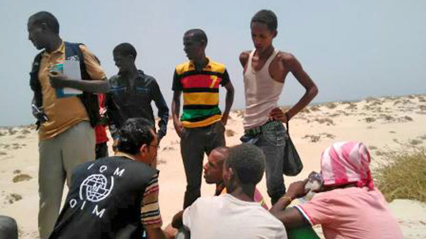 IOM staff assist Somali, Ethiopian migrants who were forced into the sea by smugglers (UN Migration Agency - IOM).