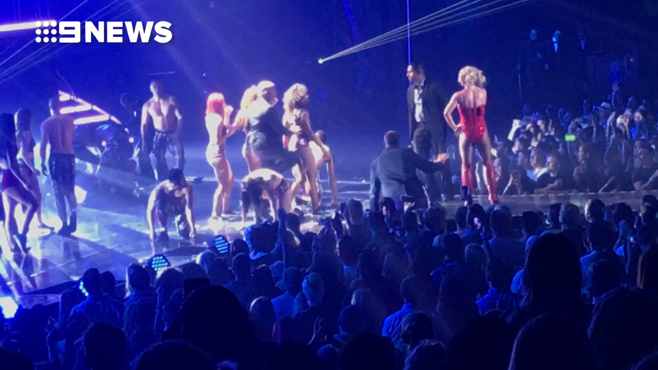 'What's going on?' Spears appeared panicked during the stage invasion.