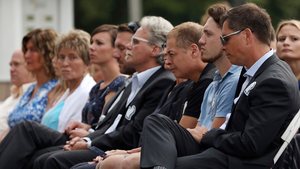 Don Damond, right, sits with family and friends during the memorial service. (AAP)