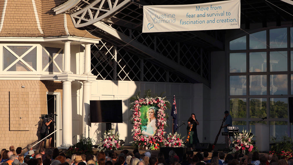 A pair of musicians play didgeridoos during the memorial service. (AAP)