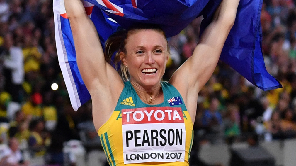 Australia's Sally Pearson celebrates with her national flag after winning the final of the women's 100m hurdles athletics event at the 2017 IAAF World Championships at the London Stadium in London on August 12, 2017. (AFP)