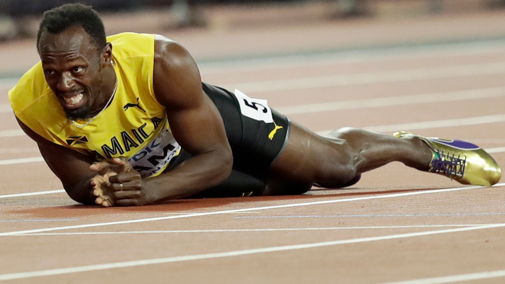 Usain Bolt fell to the ground after the injury. (AFP)
