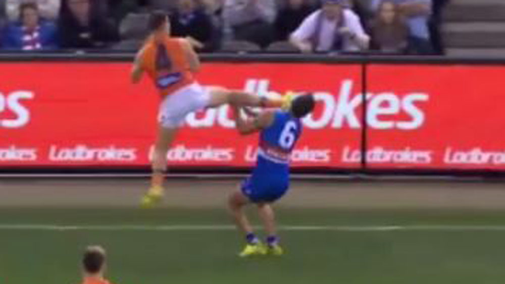 Toby Greene makes contact with Luke Dahlhaus.