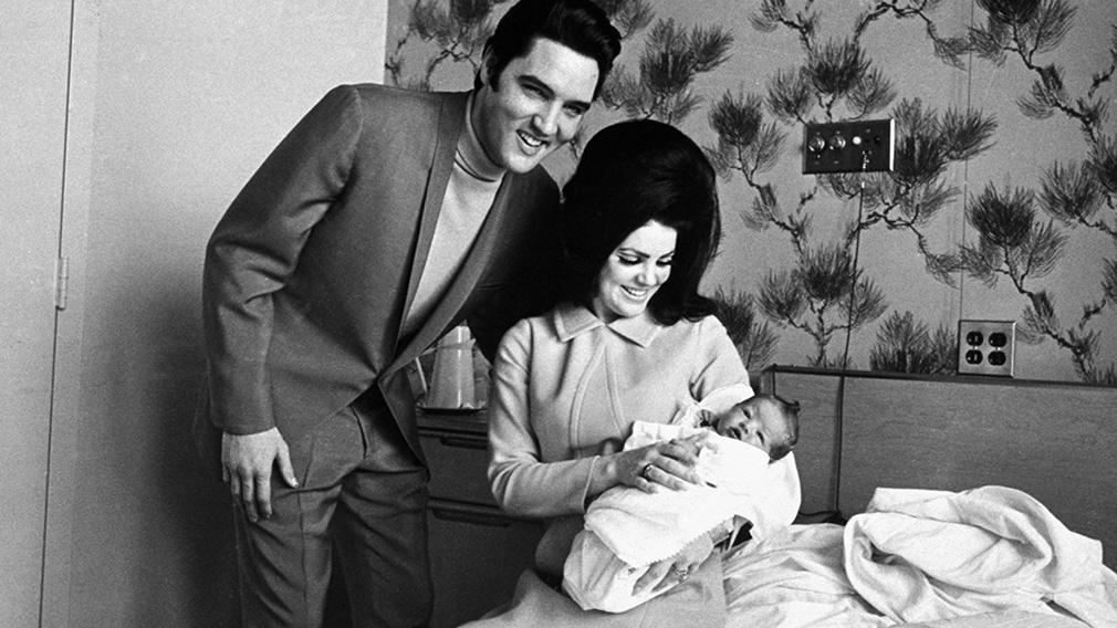 The couple with their daughter Lisa Marie Presley. (AAP)