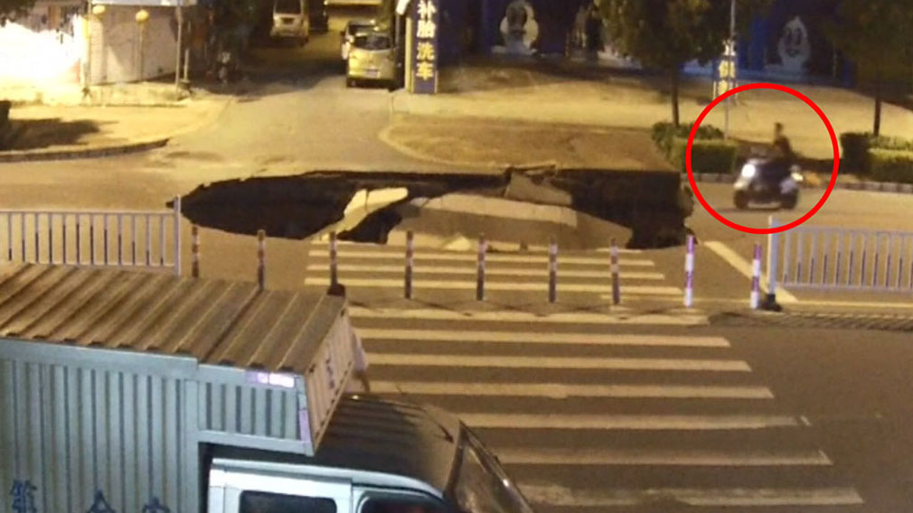 Scooter rider drives straight into sinkhole