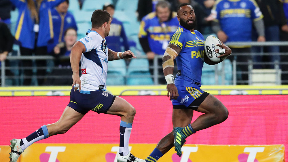 Parramatta's Semi Radradra is pursued by Ash Taylor. (Getty)