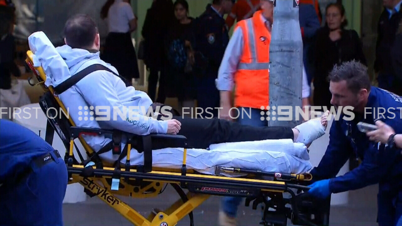 Two people have been hurt after a metal panel was torn off a building at a railway station in Sydney's CBD. (9NEWS)