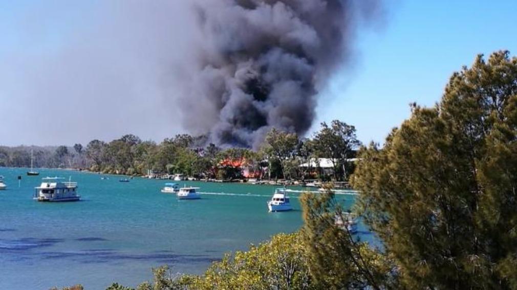 Fierce blaze destroys three riverside homes in Noosa