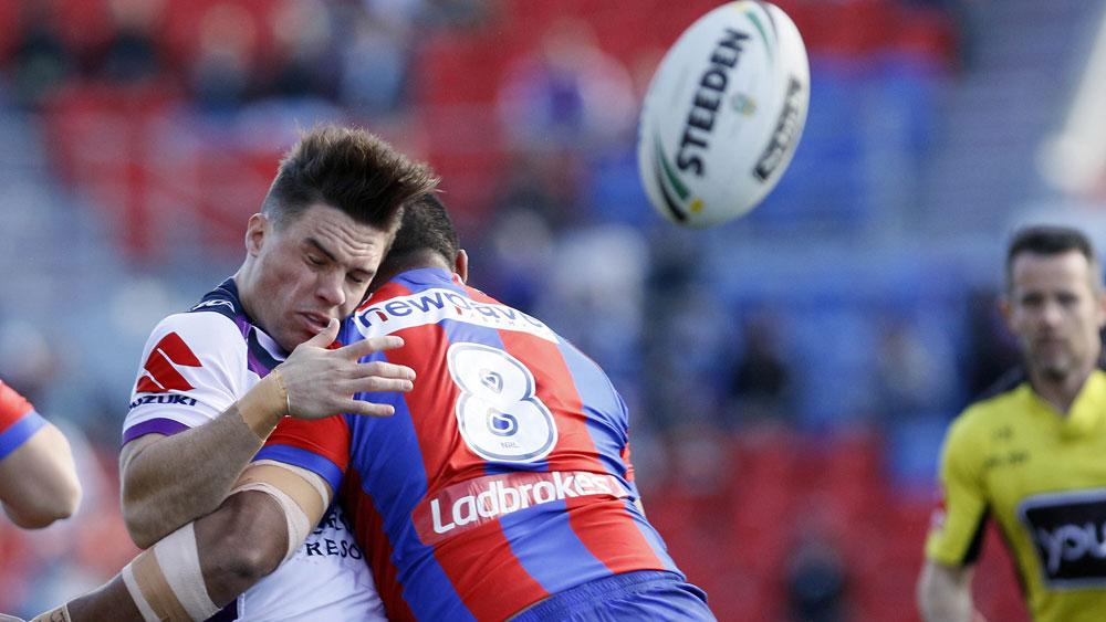 Melbourne Storm halfback Brodie Croft gets swamped. (AAP)