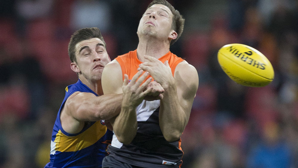Wests Coast's Elliott Yeo and GWS star Toby Greene battle for possession. (AAP)
