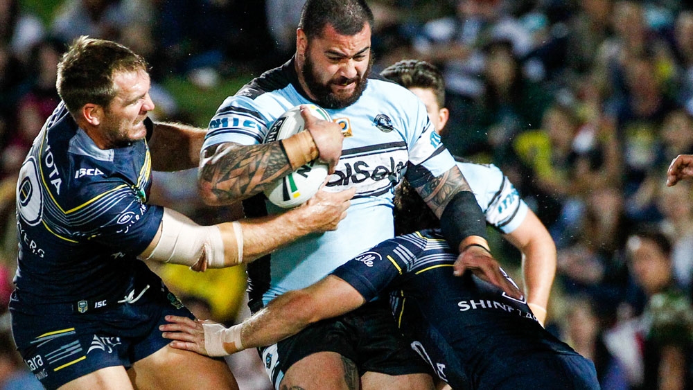 Sharks prop Andrew Fifita takes on the Cowboys' defence. (AAP)