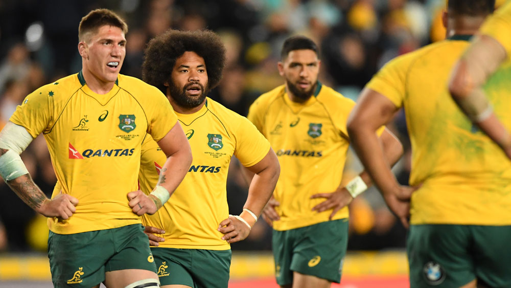 Wallabies players during their heavy loss to the All Blacks. (AAP)