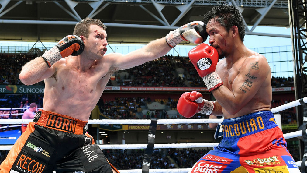 Manny Pacquiao of the Phillipines (right) is struck Jeff Horn of Australia down during the WBO World Welterweight Title fight at Suncorp Stadium in Brisbane on July 2. (AAP)