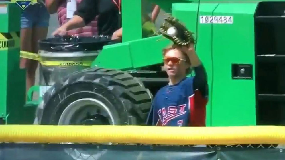 Little Leaguer flips over fence for epic catch